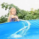 Little girl splashing water Royalty Free Stock Photos