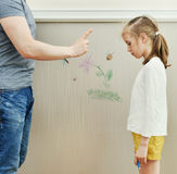 Little girl spoiled the wallpaper. Stock Photography