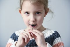 Little girl with a spoon royalty free stock images