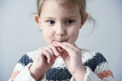 Little girl with a spoon royalty free stock image