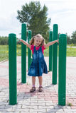 Little girl on a sport trainer outdoors in the park Stock Images