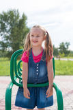 Little girl on a sport trainer outdoors in the park Stock Photos