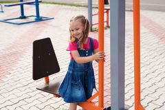 Little girl on a sport trainer outdoors in the park Royalty Free Stock Image