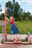 Little girl on a sport trainer outdoors in the park Royalty Free Stock Photography