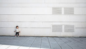 Little girl with sportive look posing over wall Royalty Free Stock Photo