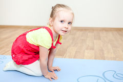 Little girl during sports games is on mat royalty free stock image