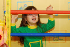 The little girl and a sports ladder Stock Photos