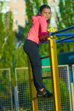 Little girl in sportswear on the playground Stock Image