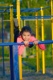 Little girl in sportswear on the playground Stock Images