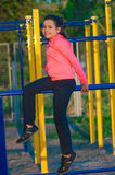 Little girl in sportswear on the playground Stock Photography
