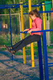 Little girl in sportswear on the playground Stock Photos