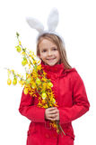 Little girl in spring clothes and flower branch Stock Image