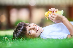 Little girl with a spring duckling Stock Image