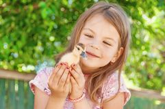 Little girl with spring duckling. Poultry in the hands of the c. Hild. Duckling close-up royalty free stock photography