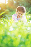 Little girl on the spring field Royalty Free Stock Photo