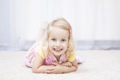 Little girl in spring flower dress Stock Images