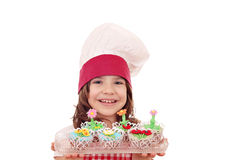 Little girl with spring flowers cakes Stock Images