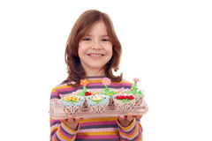 Little girl with spring flowers muffin Stock Photography
