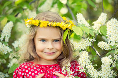 Little girl in spring flowers Stock Photography