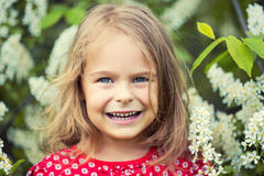 Little girl in spring flowers Royalty Free Stock Photo