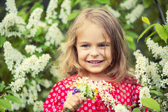 Little girl in spring flowers Royalty Free Stock Photos