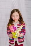Little girl with spring flowers in  vase Royalty Free Stock Photography
