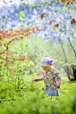 Little girl in spring forest Stock Photo