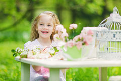 Little girl in spring garden Royalty Free Stock Photography