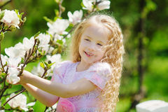 Little girl in spring garden Stock Images