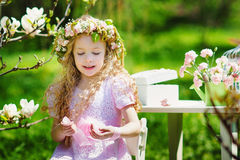 Little girl in spring garden Royalty Free Stock Photo