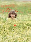 Little girl on spring meadow Stock Photos