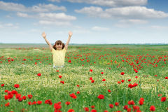Little girl on spring meadow Stock Photo