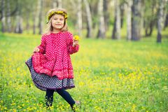 Little girl in spring park. Portrait of little girl on a flower field Stock Images