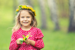 Little girl in spring park. Portrait of happy little girl in spring park Stock Images