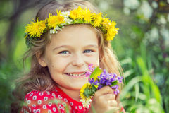 Little girl in spring park. Portrait of happy little girl in spring park Stock Image