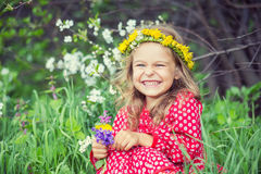 Little girl in spring park. Portrait of happy little girl in spring park Stock Photo