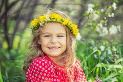 Little girl in spring park. Portrait of happy little girl in spring park Royalty Free Stock Images