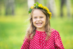 Little girl in spring park. Portrait of happy little girl in spring park Royalty Free Stock Image