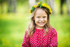 Little girl in spring park. Portrait of happy little girl in spring park Stock Photos