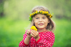 Little girl in spring park. Portrait of happy little girl in spring park Royalty Free Stock Photography