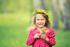 Little girl in spring park. Portrait of happy little girl in spring park Stock Photography