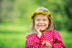 Little girl in spring park. Portrait of happy little girl in spring park Royalty Free Stock Photo