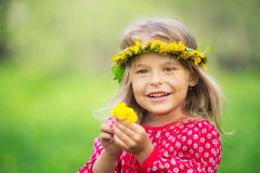 Little girl in spring park. Portrait of happy little girl in spring park Royalty Free Stock Photos