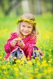 Little girl in spring park. Portrait of happy little girl on a flower field Stock Image