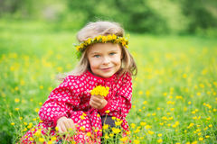 Little girl in spring park. Portrait of happy little girl on a flower field Stock Photos