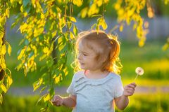 Little girl in spring sunny park Royalty Free Stock Photography