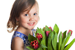 Little girl with spring tulips Royalty Free Stock Photography