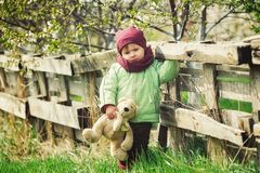 Little girl on a spring walk in the Park Stock Photo