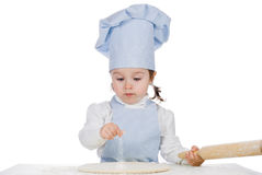 Little girl sprinkle flour on pizza dough Stock Photo