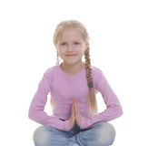 The little girl squatting crosslegged. Isolated on a white background Stock Photography